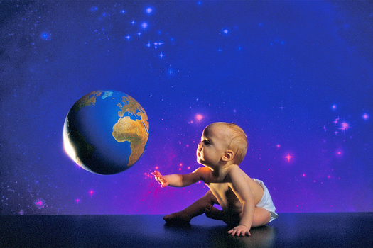 Little baby in diapers reaching out for earth-shaped ball