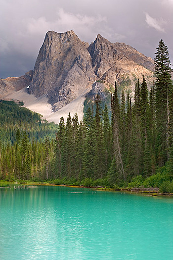 Green pool with mountain in background
