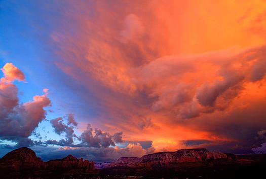 Red-orange sunset over desert landscape