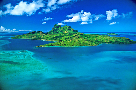 Emerald-green island in blue ocean