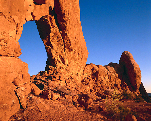 Red rock formation with large window
