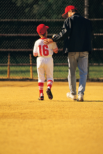 Father with child in a baseball uniform