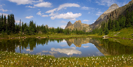 A calm reflecting pond in a mountain setting