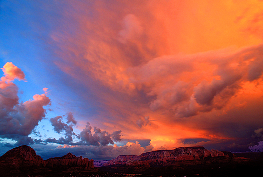 Red-orange sunset over mountains