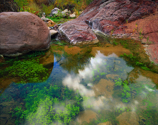 Mountain pool reflecting clouds