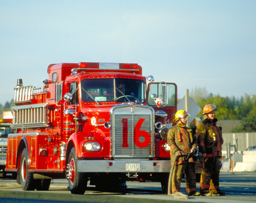 Firemen and red fire truck