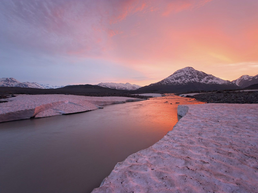 Sunset and Snow - Alsek River by Don Paulson
