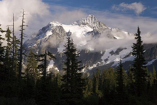 Mountain peak in mist by Don Paulson