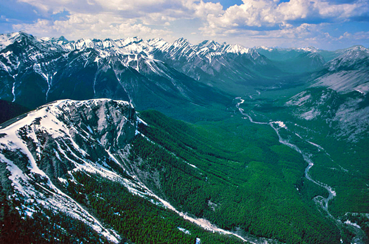 Snow peaked mountains and river valleys