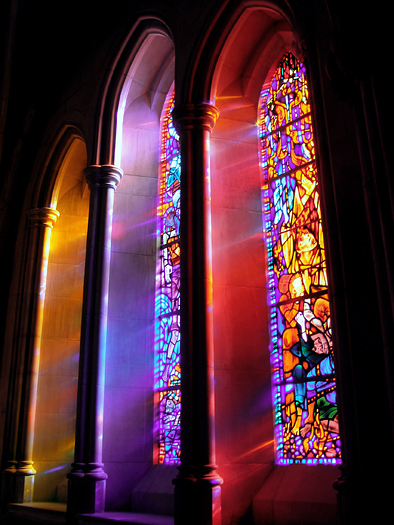 Lights passing through a stained glass window