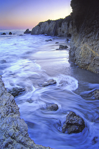 beach sunset boulders and tide at el matador beach near malibu california usa north america