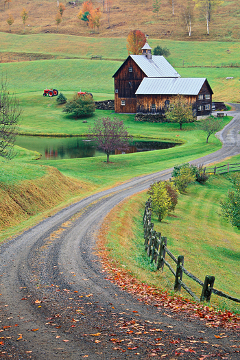 Winding dirt road leading to a farmhouse near Wodstock, Vermont