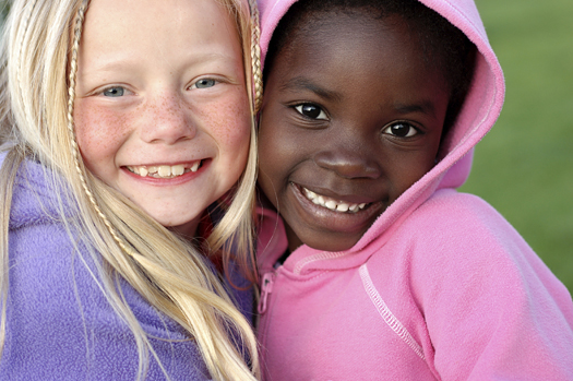 Two adorable girls with adorable smiles! They are sisters by adoption