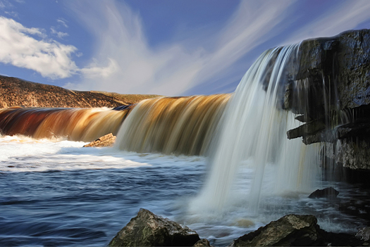 Wide falls with multi-colour water and the spacious sky