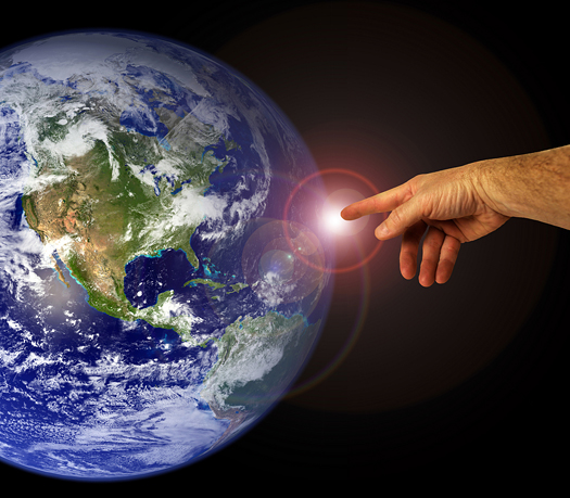 A hand touches the earth. Mankind and peaceful existence