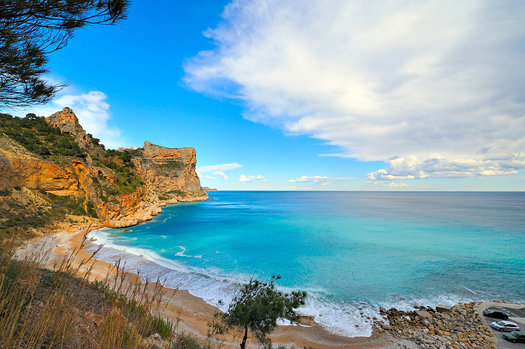 view of a gorgeous mediterranean coast beach in summertime