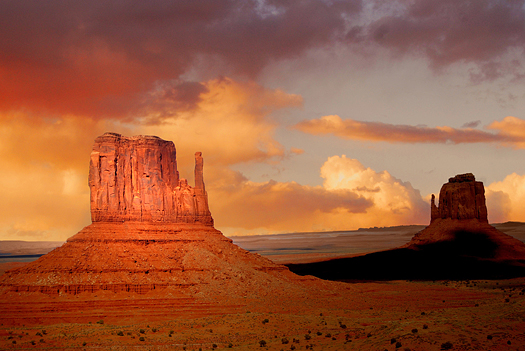Twin peaks of rock formations in the Navajo Park of Monument Valley Utah