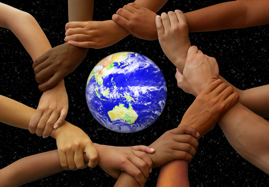 Linked hands framing the earth in a global team theme