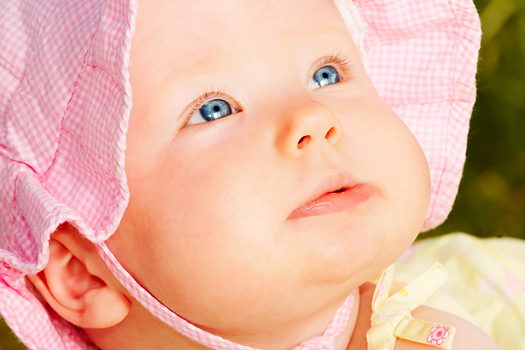 Adorable baby in  pink sunhat
