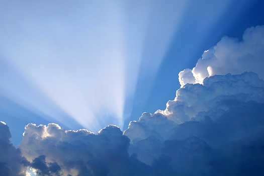 Sun rays breaking over clouds