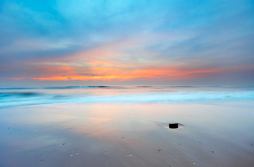 beautiful sunset on the beach in blue and pink