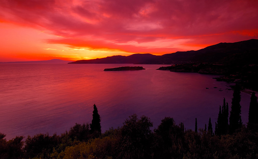 A spectacular red and pink sunset over the bay of Kardamili, southern Greece