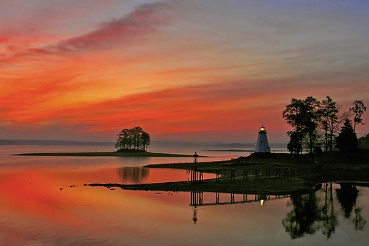 Children's Harbor in red sunset with lighthouse
