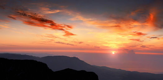 Meeting of a dawn highly in mountains, the beautiful sea and clouds