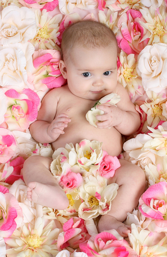 Baby in bed of flowers