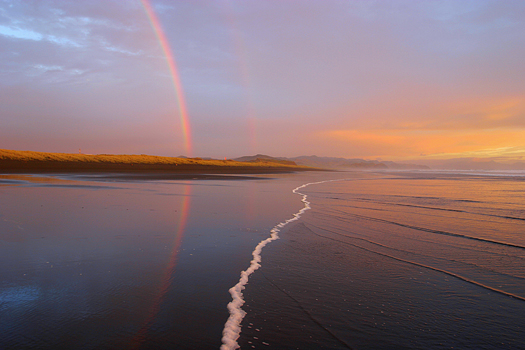 Rainbows on a beach, Taharoa, New Zealand