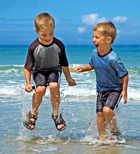 Two little boys playing in the sea