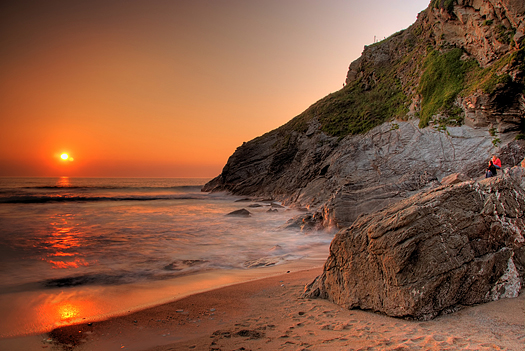 Lusty beach with red sunset in Newquay, Cornwall, UK
