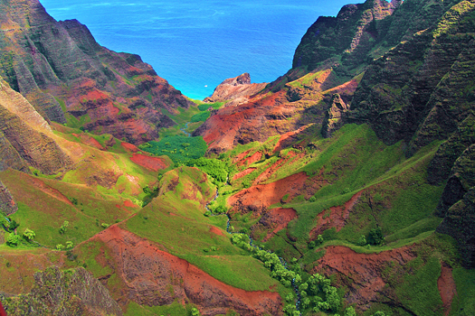 A valley in reds and greens at Kauai Hawaii