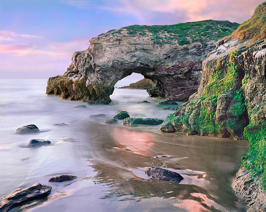 A natural arch along the Pacific coastline.