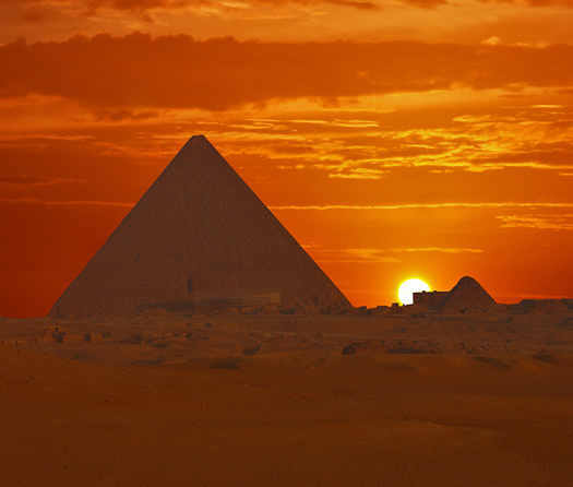Cheops Sunrise - pyramids against a red sunrise