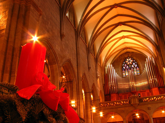 Inside a church with vaulted ceiling at Christmas time