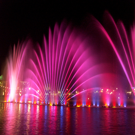 Colored pink fountain at night