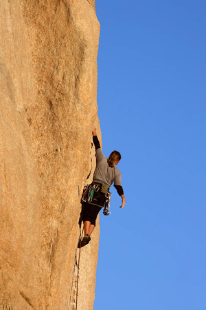 Female mountain climber by Don Paulson