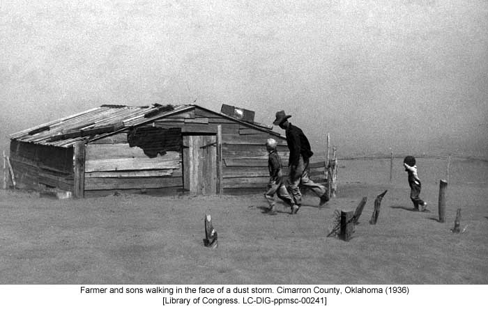 Farmer and sons walking in the face of a dust storm. Cimarron County, Oklahoma (1936) [Library of Congress. LC-DIG-ppmsc-00241]