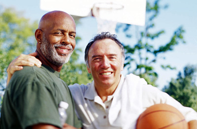 Two middle aged men with a basketball