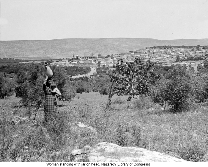 Woman standing with jar on head, Nazareth [Library of Congress]