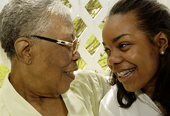 laughter with respect - And older and a younger woman share respectful laughter