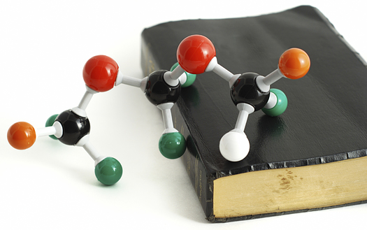 Science and Faith. Bible and chemical molecular model