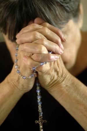 Elder woman in deep prayer