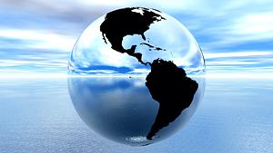 chrome earth against blue sky on water